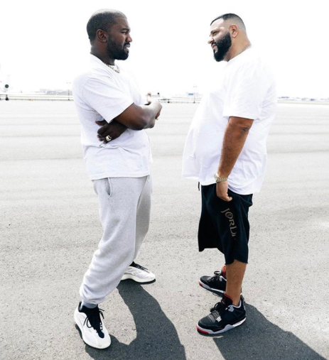 Kanye West takes off his unreleased Yeezy sneakers and gifts to DJ Khaled before they both walk off to their respective private jets (video)