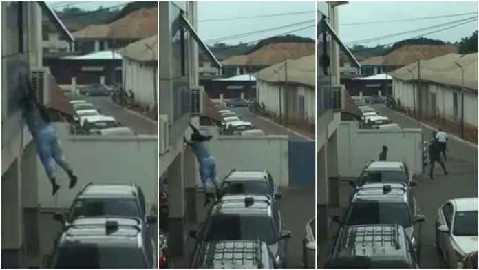 Lady jumps down from window after robbing a bank (video)