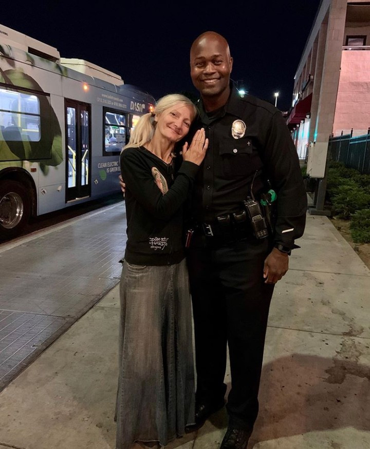 Emotional moment homeless opera singer reunited with the cop who made her go viral (video)