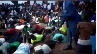 Pastor Paul Muwanguzi while flogging the church membe